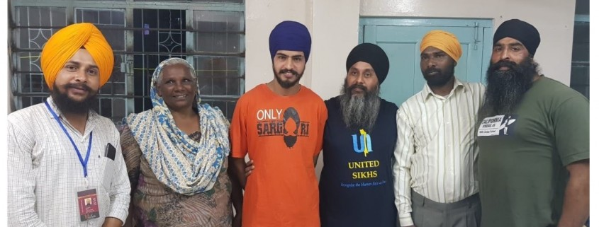 United Sikhs Ground Coordinator Mohinderjit Singh (Center) stands with Anil Singh (to the right of Mohinderjit) and Bittu Maci (to the left)